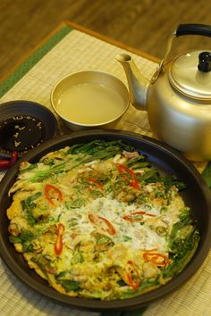 Pajeon and Makgeolli - During the monsoon season, one day it'll be nice, then then next day it'll rain. If you're hungry, why not try some Pajeon and Makgeolli? It's the best combination during this time.