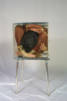 Natasha in a small perspex box