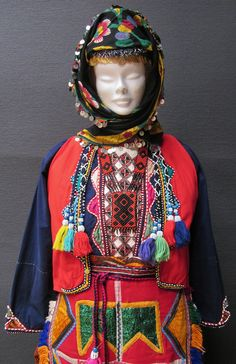 Close-up of the traditional festive/ceremonial costume of some Alevi-Türkmen villages in the northwestern part of the Sivas province.  1970-2000 (and still in use).  The costume is adorned with colourful patchwork, embroidery, woollen tassels and beadwork.  (Kavak Costume Collection-Antwerpen/Belgium).