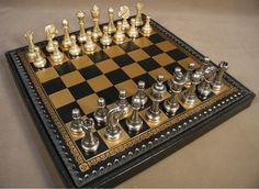 """The Game Supply - Staunton Metal Chessmen and Backgammon on reverse, a cool combo set. 3"""" King, 14"""" x 14"""" Pressed Leather Chest, 1.25"""" squares, with 1"""" king base width.  #leatherchessboard #metalchessmen"""