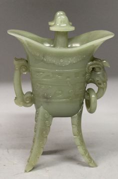 A 20th century Chinese olive green jade tripod censer, of jue bronze form. Est. £400-£600.