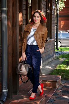 Stand out among other stylish civilians in a tobacco leather jacket and navy blue floral chinos. Rock a pair of red suede flats for a more relaxed aesthetic. Shop this look for $281: http://lookastic.com/women/looks/scarf-crew-neck-t-shirt-chinos-ballerina-shoes-necklace-bracelet-satchel-bag-jacket/4757 — Red Floral Silk Scarf — White and Navy Horizontal Striped Crochet Crew-neck T-shirt — Navy Floral Chinos — Red Suede Ballerina Shoes — Gold Necklace — Gold Bracelet — Dark Brown ...