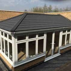 SupaLite charcoal grey roof by Solarframe Limited, Yorkshire. Conservatory Roof, Roofing Systems, Yorkshire, Four Square, Charcoal, Garage Doors, Country, Create, Grey