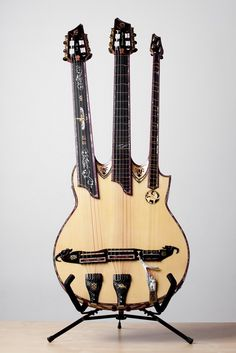 """FuseTar """" Lucifer"""", is a triple neck (guitar & setar), 16-stringed, new hand-made music instrument, created by Iranian multi-instrumentalist and composer Shahab Tolouie."""