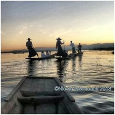 Photo credit Nicole Arsenault - Leg rowers on a sunset canoe ride on Inle Lake, Burma (Myanmar)