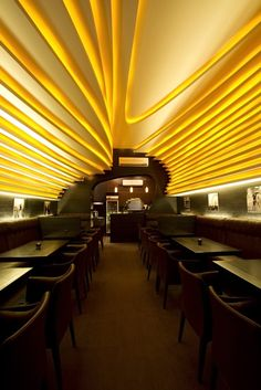 Yellow ceiling, contemporary coffers, black and yellow interior