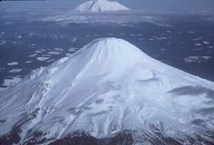 Aerial view of Mount St. Helens from the west (1976). Mt Adams in the background. Washington State, USA.