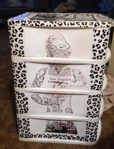 Marilyn Monroe plastic dresser I covered with cheetah print and a poster.