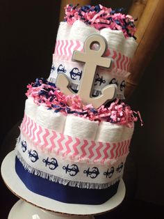 Nautical Diaper Cake, Pink and Navy Diaper Cake, Baby Shower Centerpiece, New Baby Gift, Nautical Baby Shower, Baby Girl Shower by MrsHeckelDiaperCakes on Etsy https://www.etsy.com/listing/242899292/nautical-diaper-cake-pink-and-navy