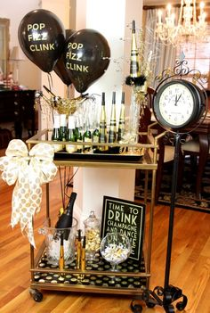 Year's Eve Party - B. Lovely Events New Years Eve Bar Cart. Wallpaper/scrapbook/gift wrap paper on shelving.New Years Eve Bar Cart. Wallpaper/scrapbook/gift wrap paper on shelving. Bar Cart Styling, Bar Cart Decor, New Years Eve Decorations, Party Table Decorations, Deco Disco, Silvester Diy, Party Silvester, Gold Bar Cart, Nye Party