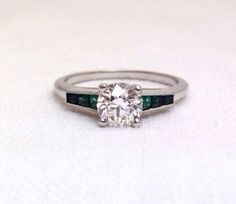 Hey, I found this really awesome Etsy listing at https://www.etsy.com/listing/168239172/art-deco-diamond-emerald-ring
