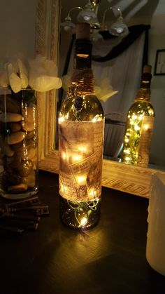 Upcycled, decorative, wine bottle lamp. This bottle is decoupaged with a French-inspired label. Bottle is finished with hemp twine, butterfly
