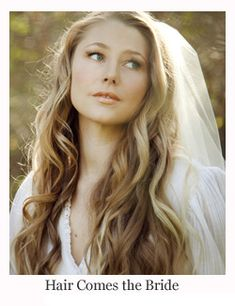 1970's inspired bohemian hippy bridal hairstyles. long wavy all down vintage bridal hair and makeup by Hair Comes the Bride
