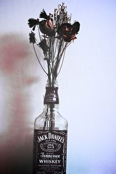#DIY #vase  - Love to #create vases (and props for shoots) from old booze bottles *P.S. I think the clear ones work best
