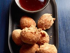 Doughnut Holes With Strawberry Syrup from FoodNetwork.com