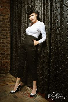 High Waisted Cropped Trousers in Black - These incredible Cropped Trousers feature a high Empire waistline.