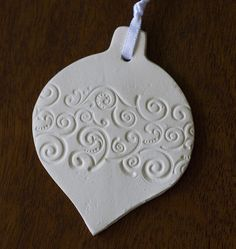 Salt dough ornament imprinted with cuttlebug folder.