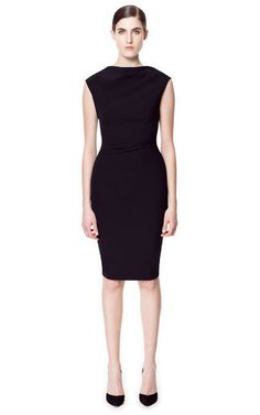 Love what his high neck Zara dress does for a woman's curves. Flaunt it!