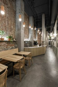 """Narrow Lebanese snack bar and bakery in Montreal features """"array"""" of ash wood furniture Deco Restaurant, Rustic Restaurant, Restaurant Lighting, Restaurant Interior Design, Cafe Interior, Kitchen Interior, Kitchen Decor, Cafe Industrial, Shop Interiors"""