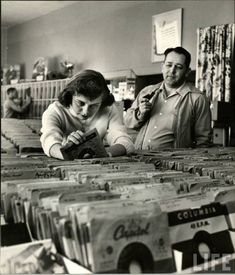 Teenage girl shopping for records (1950s)