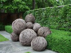 idea to make garden spheres with grapevine and hypertufa slurry
