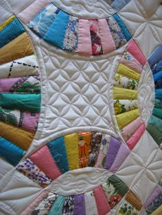 Antique Double Wedding Ring Quilt, finished and quilted by Esther at Threads on the floor.  In the blocks she alternated between a cathedral windows quilting design, shown here, and meandering feathers.