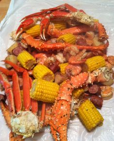 Frogmore Stew (no frogs)  Ingredients only -   6 qts water   3/4 cup Old Bay Seasoning   2 lbs new red potatoes  2 lbs hot smoked sausage links, cut into 2 inch pieces 12 ears corn - husked, cleaned and quartered  3 lbs large fresh shrimp, unpeeled.    2 lbs crablegs