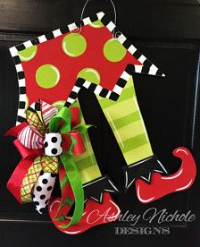 "How fun and whimsical this Elf Feet door hanger is!! This piece is hand cut and hand painted. Made using ¼"" plywood with a painted back for a more polished look.   24 H x 19W  Includes fun bow"