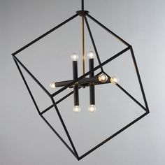"Check out Be Squared Modern Chandelier from Shades of Light The asymmetrical design and use of mixed metals adds a modern element to this stately chandelier. The brass accents on the bronze finish create a handsome sophisticated look. Overall height is 70"". Can be hung from a sloped ceiling. 8x40 watt max candle base sockets. (31.25""Hx25.5""W)."