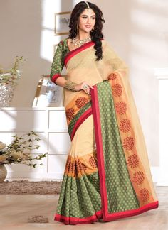 Everyone will admire you when you wear this clad to elegant affairs. Outstanding craftmanship of embellishments exhibited in this multi colour net designer saree. This ravishing attire is amazingly em...