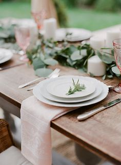 Simple table setting - organic palate with rustic white dinnerware, flax colored linens, wood tones, and simple greens.
