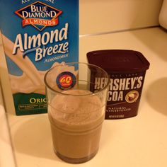Frozen banana, 2/3 cup almond milk, 1/2 tbls cocoa powder. Tastes exactly like a chocolate shake and about 125 cals!