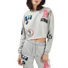 Petite Topshop Badged Crop Sweatshirt ($68) ❤ liked on Polyvore featuring tops, hoodies, sweatshirts, grey multi, petite, petite tops, crew neck crop top, grey crewneck sweatshirt, petite long sleeve tops and crew-neck sweatshirts