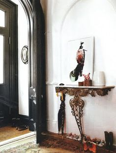 Jenna mentions that the entry is painted in Off Black oil eggshell by Farrow & Ball. Source: Living etc.