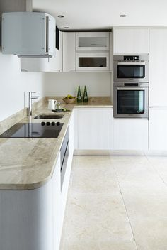 Combine different finishes like Dijon Tumbled Limestone (http://www.mandarinstone.com/product/_/72/dijon-tumbled-limestone-tile/) flooring with Royale Marble Polished worktop (http://www.mandarinstone.com/product/_/155/royale-polished-marble-tile/). Create your own made to measure worktop our Fabrication service, find out more on our website http://www.mandarinstone.com/fabrication/