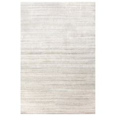 Subtly chic, Dash and Albert area rug lends neutral texture in graduated shades of white. This hand-knotted floor covering lends a luxurious accent to modern interiors.