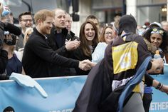 Prince Harry, Prince William, Duke of Cambridge and Catherine, Duchess of Cambridge cheer on runners at a 'Heads Together' cheering point along the route of The Virgin Money London Marathon 2017 on April 23, 2017 in London, England.