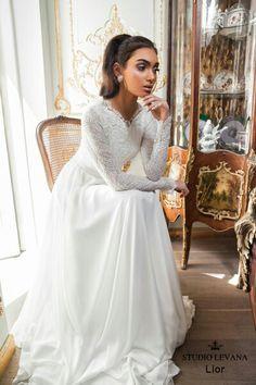 Feel like a regal bride in Studio Levana modest wedding dress
