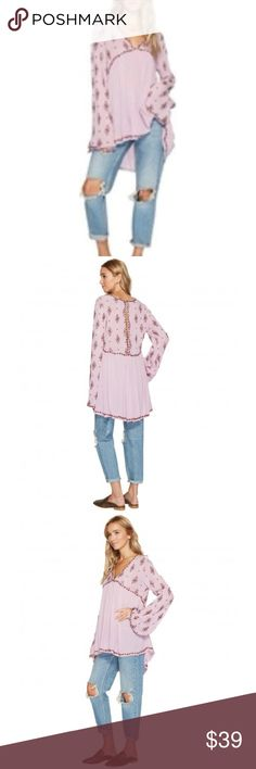 Free People Embroidered Bell Long Sleeve Top Brand new with tags. Boho style top.  Fashioned with fabulous flare sleeves for a touch of drama, this decidedly feminine essential is an easy choice when you want to leave a lasting impression. Its lavish silhouette features the silky-soft touch of rayon, blending elegance with all-day comfort for a world-class top you'll love.  Pullover V-neck Long flare sleeves Hand wash Rayon Free People Tops Tunics
