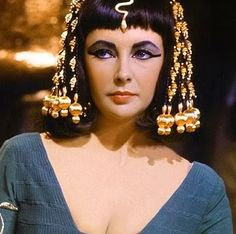 This is actress Elizabeth Taylor displaying traditional Egyptian attire. Egyptians wore the most makeup from the ancient people. Trademark looks included heavy eyeliiner made from material galena. Bright eyeshadow which believed to keep dust out to eyes were made from crushed malachite. Due to the believed benefits of makeup both men and women enjoyed wearing such things.
