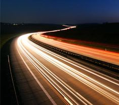 This is a photo of carlights with slow shutter speed, to create this motion blur.