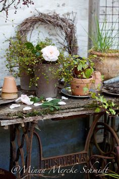 Rustic potting table made with a sewing machine base (maybe, I'm just guessing that's what it is)