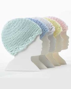 Snug crocheted hats for babies aged Preemie through 18 months. Shown in Bernat Softee Baby.