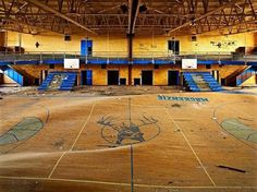 A school gymnasium in Detroit, Michigan, developed a warped floor as a result of heavy water damage Abandoned Detroit, Abandoned Buildings, Abandoned Places, Abandoned Castles, Terrain Basket, Beijing, School's Out Forever, Haunting Photos, Hotel Services