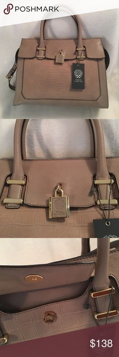 """Vince Camuto🏵Heidi Satchel--Taupe This beautiful taupe bag can be used with only the top handles or as a crossbody with the 18"""" strap. The exterior has a hidden pocket under the front flap with the padlock. The interior has a media sleeve, a zip pocket, 2 cell phone sized pockets and a pen pocket. It is a beautiful bag which can be also used as an updated briefcase. Never been used, is in perfect condition. Dust bag included. NO TRADES PLEASE! Vince Camuto Bags Satchels"""