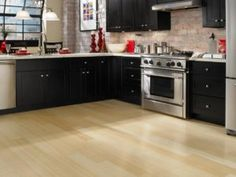 Keep your kitchen up-to-date starting with your floor. Use this guide to the hottest 2018 kitchen flooring trends ideas and find durable, stylish kitchen flooring ideas that will stay trendy for years to come. Laminate Flooring In Kitchen, Kitchen Flooring Options, Best Flooring For Kitchen, Diy Flooring, Flooring Ideas, Basement Flooring, Bathroom Flooring, Bathroom Faucets, Hardwood Floors