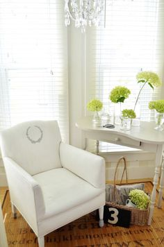 Painted and Stenciled Chair | Small Laurel Wreath Stencil, Pure White & Paris Grey Chalk Paint® decorative paint by Annie Sloan | Sew a Fine Seam http://www.sewafineseam.com/2013/07/painting-a-vinyl-upholstered-chair/