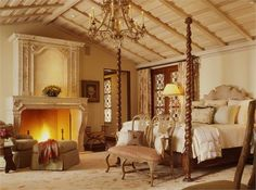 Romancing the Bedroom - fireplace bedroom with four poster bed California Camelot on HomePortfolio @stuckerhome
