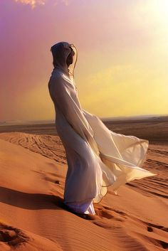 Moroccan Sahara Desert. Some dresses are specially designed for the hot desert regions to protect from sand storms, extreme hot and cold. They have nothing  to do with any Religion or Faith.