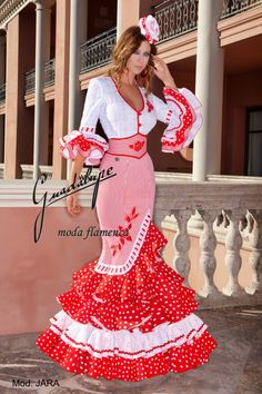 "A very stylish Flamenco feria dress. The embroidery and ""fajin"" corset belt really complete the look"